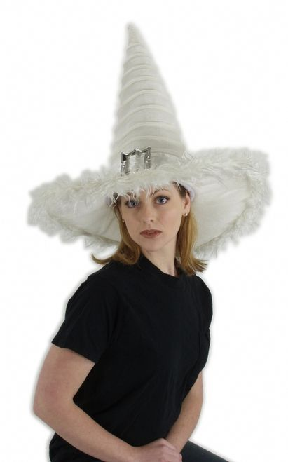 White Good Witch Costume Hat - This is a wonderful witch hat. The peak of the hat is 20 inches high and has ridges circling all the way up. The brim is 20 inches wide and is trimmed with white faux fur. The hat is made of a very soft velvety fabric and has a white satin band with a big ornate buckle in the front. Fits all sizes of heads and is adjustible with an elastic/velcro adjuster. Made by Elope it will last many wearings. #witch #halloween #yyc #costume #hat