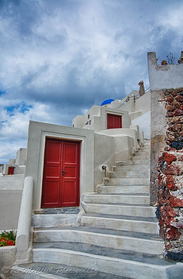 These doors are all over Oia Greece (Santorini). They look like they open into nothing but behind them are stairs descending down. Photo by Kevin McClish.
