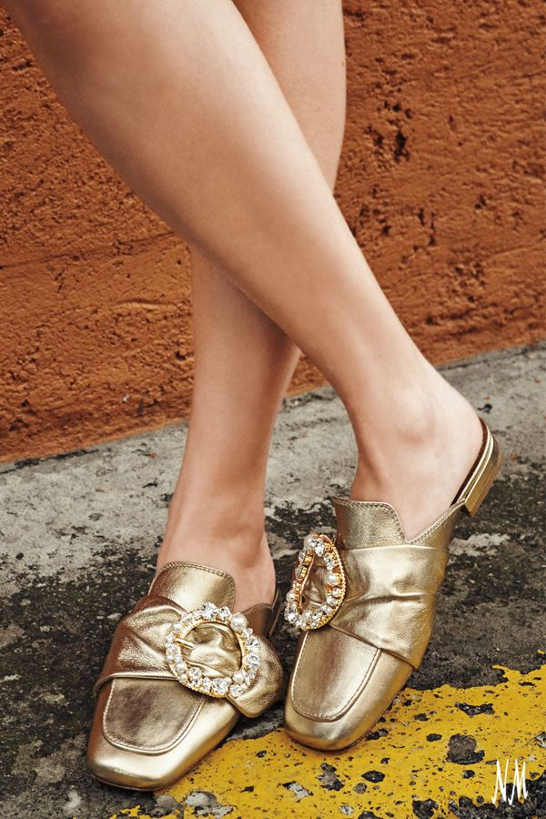 Buckle up in metallic leather mules by Miu Miu.