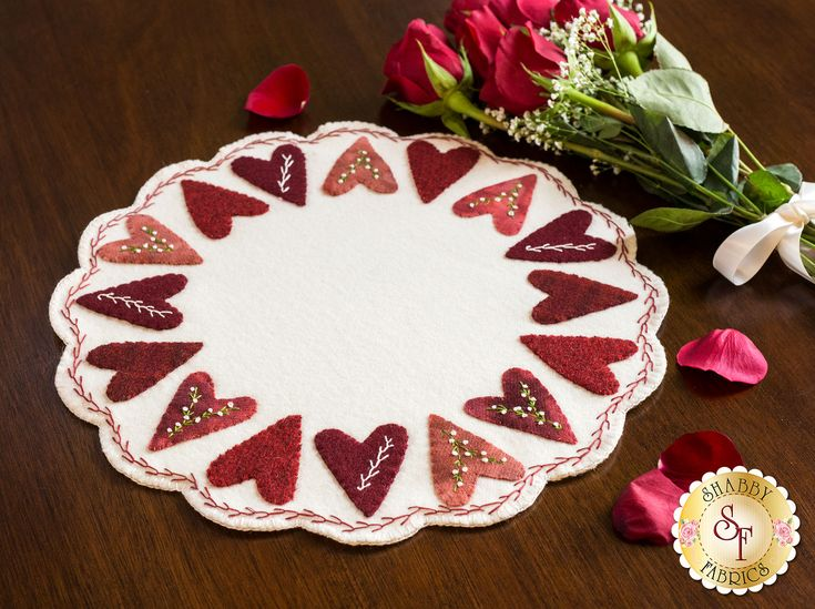 Sweetheart Wool Mat Kit: The love will show through in every stitch of this darling Sweetheart Wool Mat designed by Stacy West! Beautifully textured red and pink wool hearts are adorned by sprigs of floral hand embroidery. It's a lovely beginner-friendly project, perfect for displaying candles, a bowl of chocolates, or a vase of roses!Finishes at approximately 13½