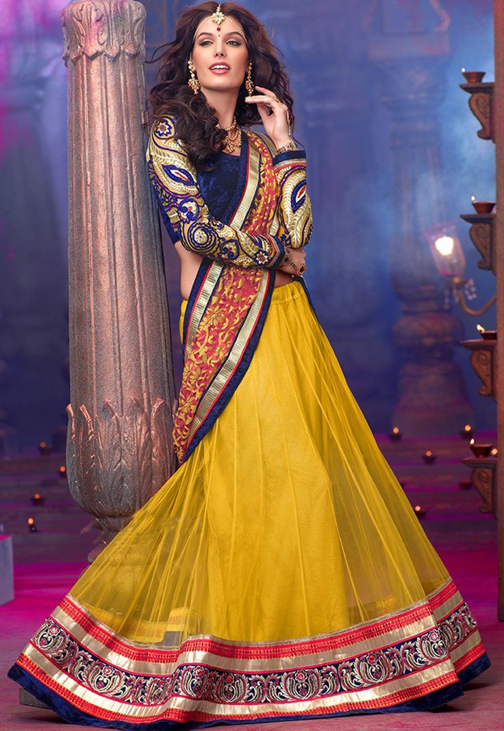 Express the beauty of feminity with this  Yellow #Net flared lehenga designed with Embroidery,Patch Work. As shown in the photo choli is available.   INR :-9310 With exciting Flat 25% discount
