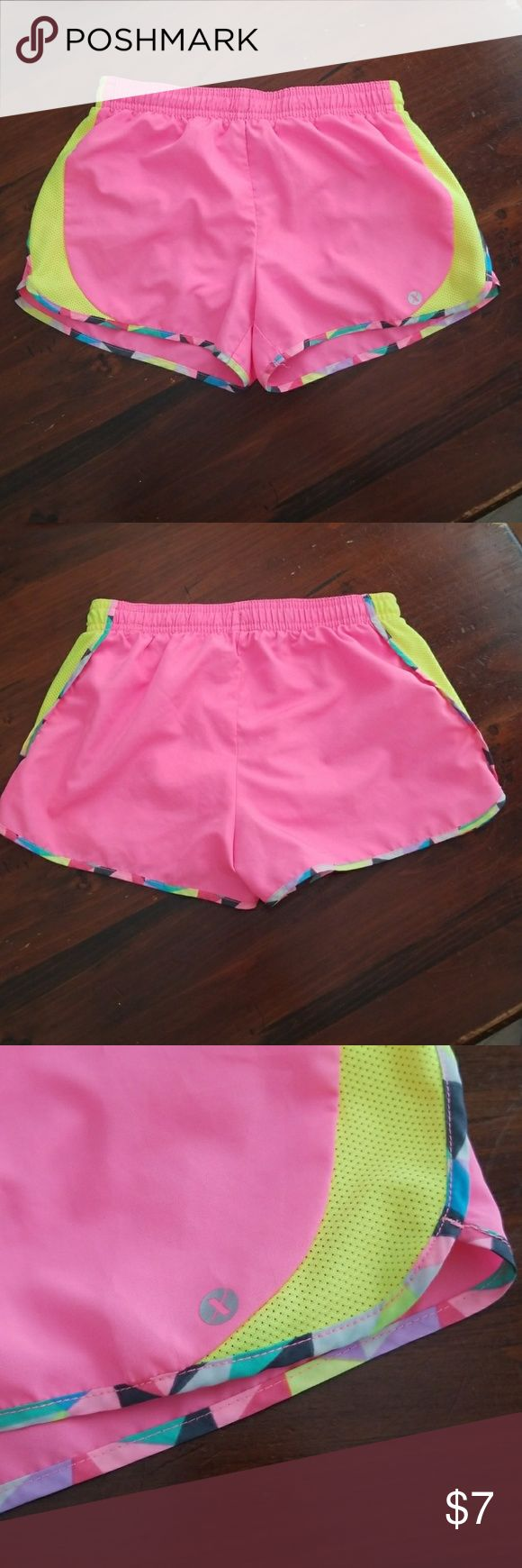 EUC Girls Athletic Shorts EUC. Underwear lined quick dry athletic shorts. Features elastic waist band and tie. Also has tightly woven mesh on the sides to keep your kiddo cool on hot summer days! Shorts are pink, neon yellow with a mix of colors boarder as shown in 3rd picture. Selling for my niece :]  Make an offer! Xersion Bottoms Shorts