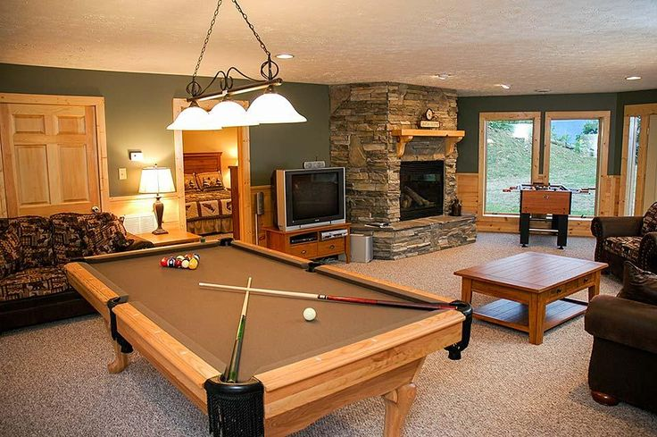 Everyone can play in this game room. Cabins in the Smoky Mountains near Gatlinburg.