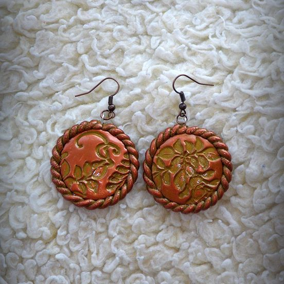 Ethnic Disc Earrings. Double sided. Harmonious combination of orange copper and dark gold in a pure ethnic style! These earrings were made from metallic dark gold polymer clay, molded and then carefully polished with wax-based copper medium, which gives the higher parts a gorgeous color and shine, as well as more depth. About 4 cm in diameter, and 5 cm long with the ear piece.