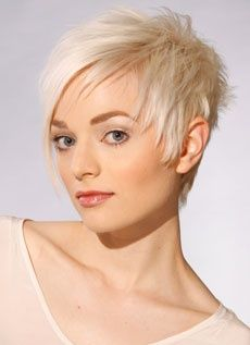 love the jagged fringe on the short side.  The color makes this cut pop!