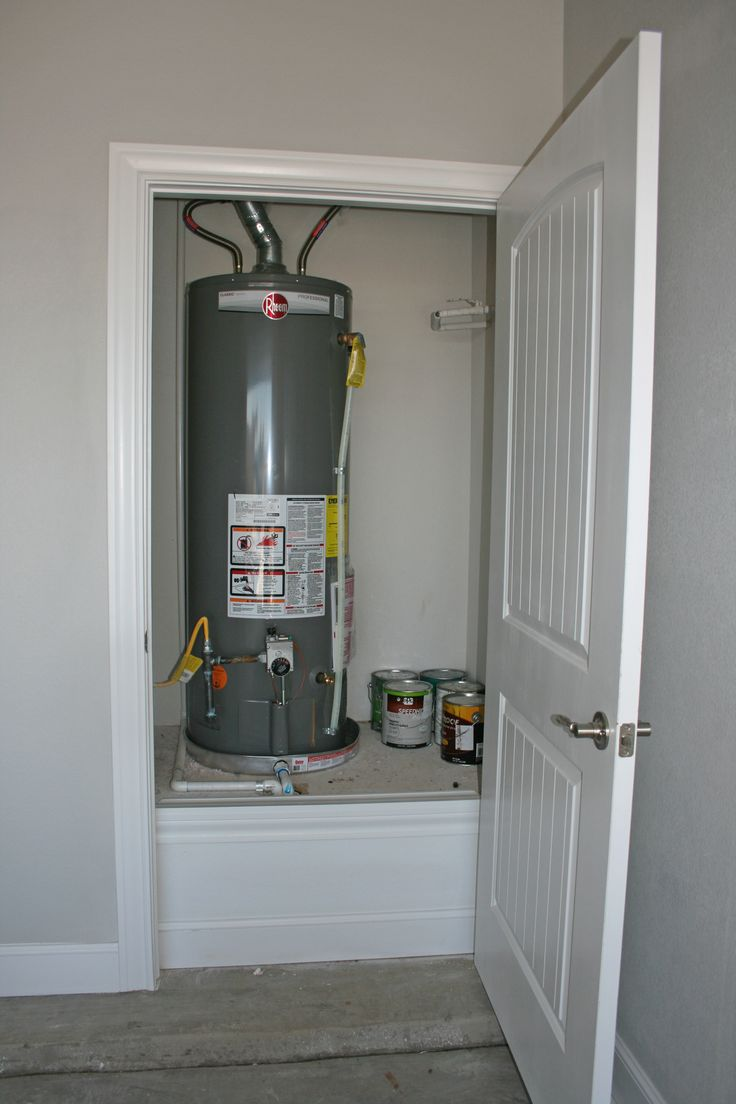 Garage Water Heater Closet | Flatland Homes by Trey Strong: HART Residence | Locker storage ...