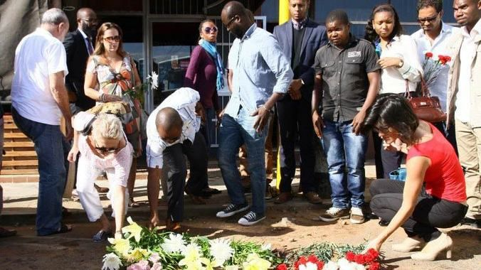 Mourning: Mozambicans pay their respects to Gilles Cistac who was gunned down outside a restaurant on March 3. (AFP)