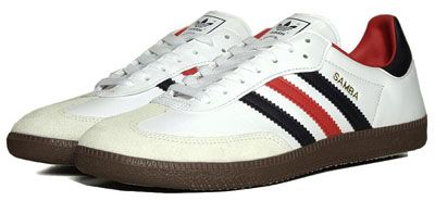 Adidas Samba trainers:  The 1960s sports/football shoe is back in an original colourway, specifically with a white leather upper, matched with navy blue and red detailing/stripes, a gum sole and gold branding.
