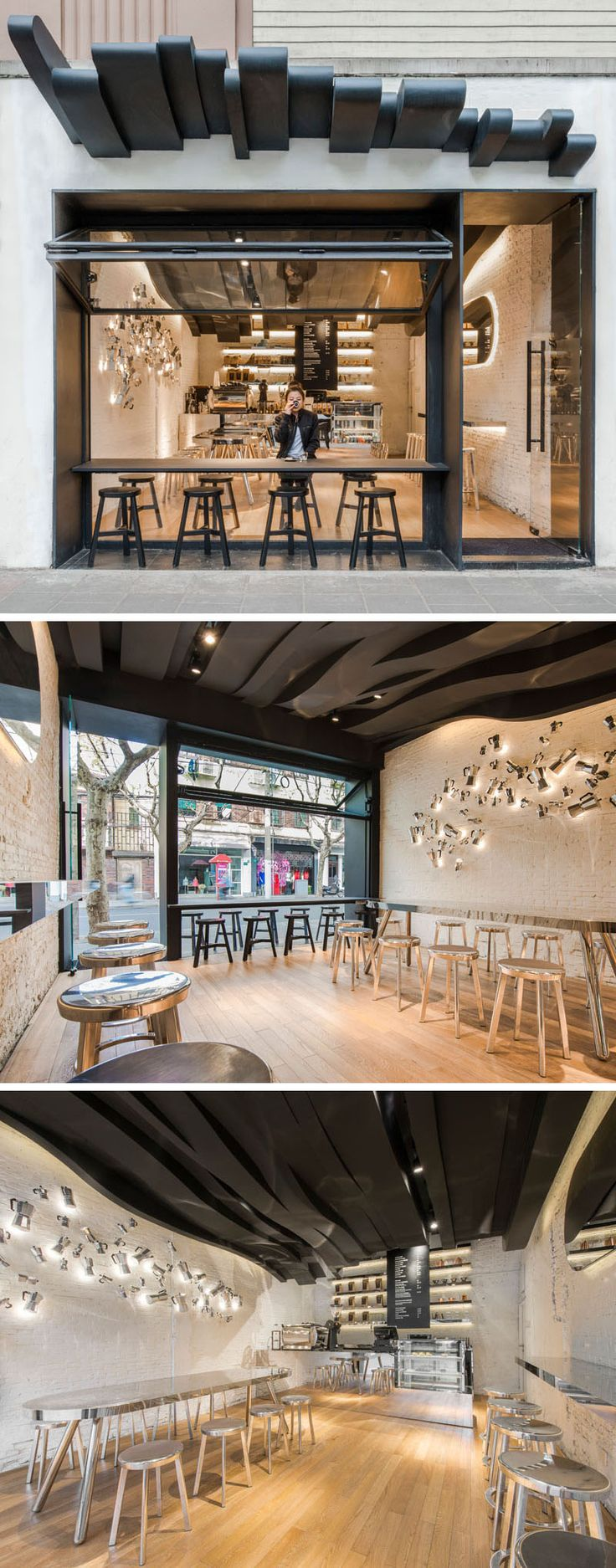 10 Unique Coffee Shops In Asia / Alberto Caiola designed Fumi Coffee, a cafe in Shanghai, China, designed to draw people into it by grabbing their attention with a sculptural ceiling that flows from the outside all the way to the back of the cafe and was inspired by the aromatic vapors of coffee.