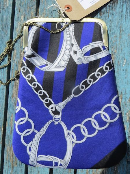 'Gucci-Esq'. An equestrian inspired 1970's headscarf has been used to great effect in thei cross-body bag. Stirrups, chains and a hunting horn depicted in white lie on a blue and black background.