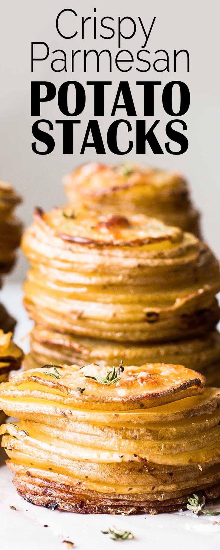 Crispy baked potato stacks with Parmesan and garlic! So easy to make in a muffin tin.