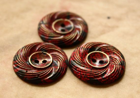 Button swirl in fimo and utee lighly polished with with brass wax
