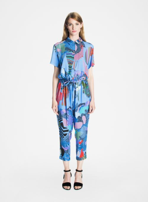 """Flashback Soundtrack. The Hohdokas jumpsuit could trigger a """"splurge alert."""" Its loose comfortable shape combined with the dazzling jungle-inspired pattern that's digitally printed make it one of this season's must-haves. It has a small flat collar, short sleeves, a fabric-covered button front closure to the drawstring waistline, and an above-ankle hem with 3 cm cuffs. A size medium has a 62 cm inseam; wear Hohdokas with heels, flats or sandals. The soft woven fabric 100% viscose."""
