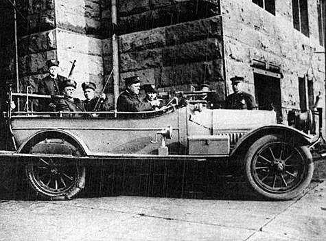 1921 riot car was used by the Denver Police. Notice the Dash Mounted Gun and hand crank siren.