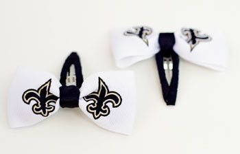 If you are watching the game tonight against the bears --- your kiddo could be wearing these! But I'm rooting for the Bears!  New Orleans Saints Clippies from Little BIG Fan