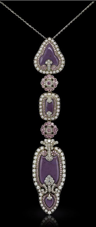 Faberge Scheherazade Long Pendant. This piece is set in 18 carat gold and silver and features 323 white and pink diamonds and white pearls totalling 9.92 carats.