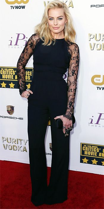 MARGOT ROBBIE Forget dresses, Robbie wore a black Elie Saab jumpsuit with lace sleeves, accessorizing with an Alexander McQueen clutch and Ileana Makri jewelry.