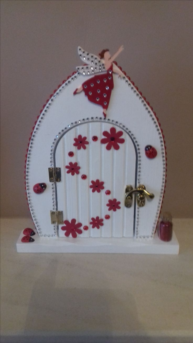 Red and white fairy door.