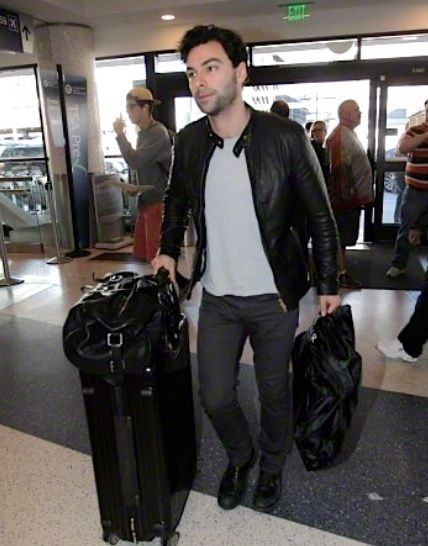 Aidan Turner arrives at LAX to fly home (January 23, 2015).
