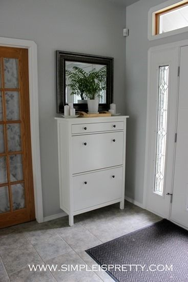 Black mirror over white shoe cabinet to tie in with my black floor tiles.
