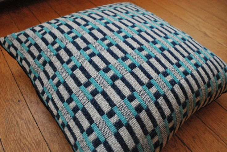 """Side view of """"Paperchain"""" woven lambswool cushion in the """"Sea"""" colourway by Heather Shields"""