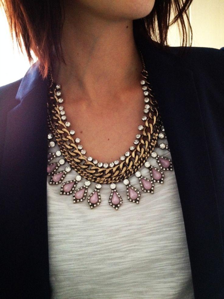 Statement necklace + white tee + blazer.
