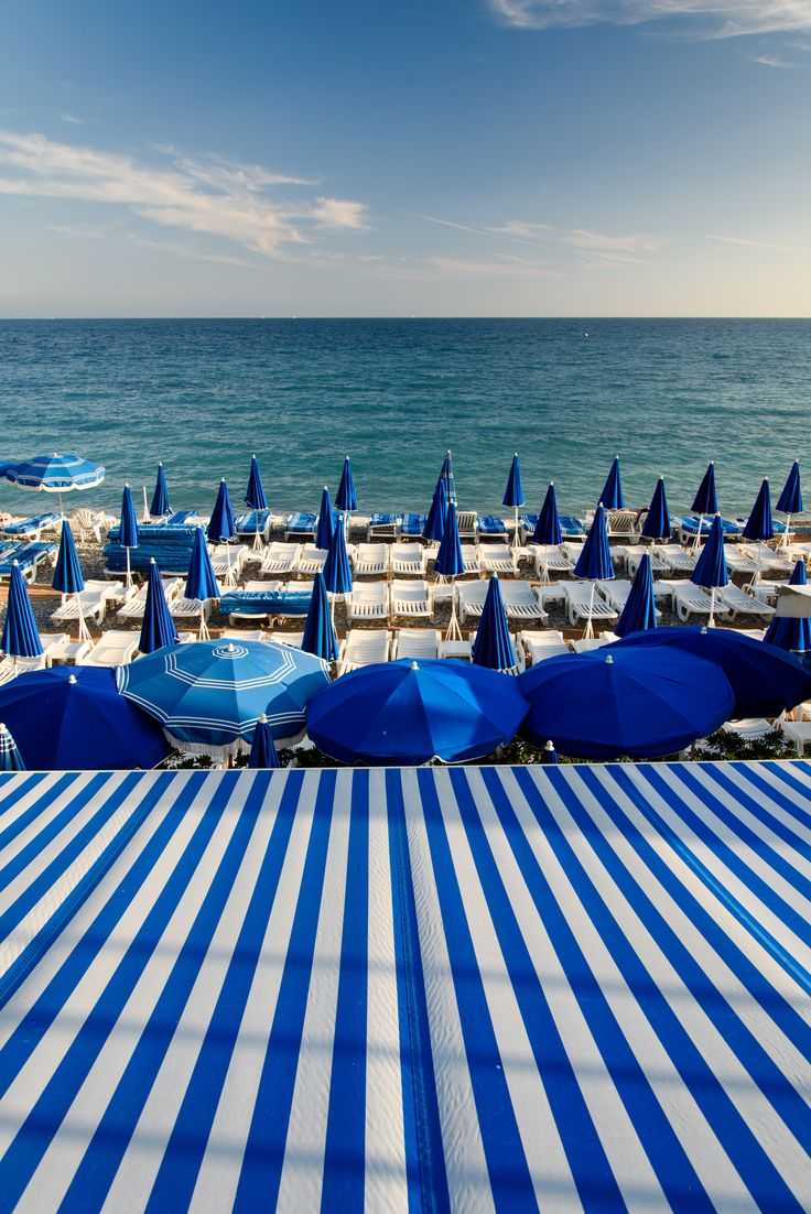 Blue and white striped awnings make for the perfect beach scene.