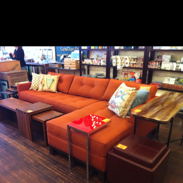 L-shaped sofa's are my fav and this orange one looks awesome!