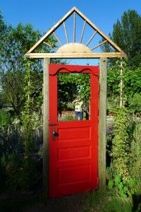 A red garden gate: I like to collect ideas like this and think about turning them into something for my people garden OR for my fairy garden. My husband could easily make a miniature door and frame like this in his woodshop. I think the fairies who live in my woods would be attracted to a little red door that looks like this one.