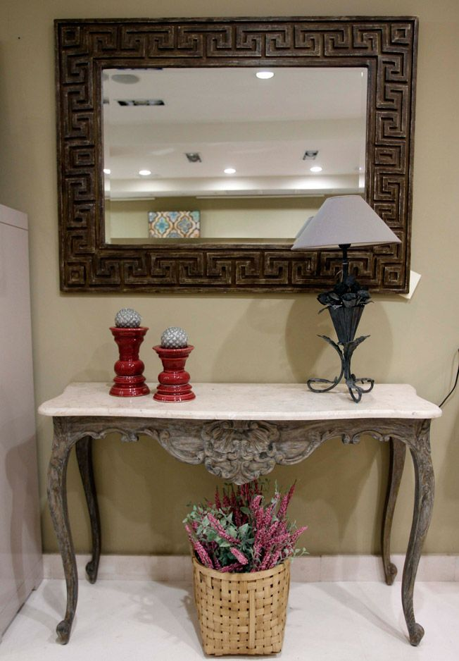 Consola isabelina tallada a mano con espejo de la firma Harrison de madera de caoba envejecida