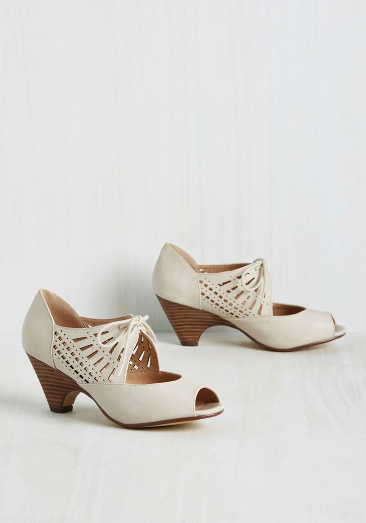 Dancey Drew Heel in Parchment. Theres no mystery about who's got the best moves when youre grooving in these light beige heels! #cream #modcloth