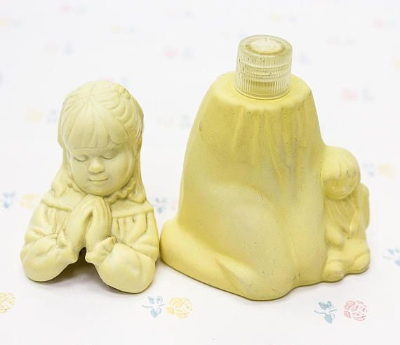 """Sweet Honesty Cologne made by Avon, 1981. This adorable perfume decanter is known as """"First Prayer"""" and takes the form of a little girl in prayer pose with her dolly at her side. The bottle is in great condition, no chips or cracks. There is a bit of discoloration as can be noted in"""