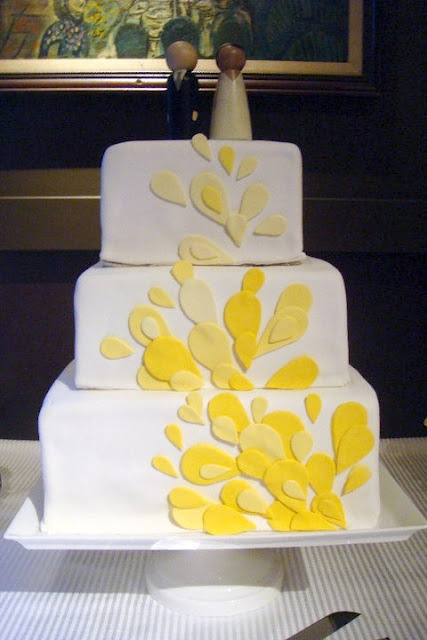 Wedding cake. Yellow fondant leaves of three shades. 3-tiered.