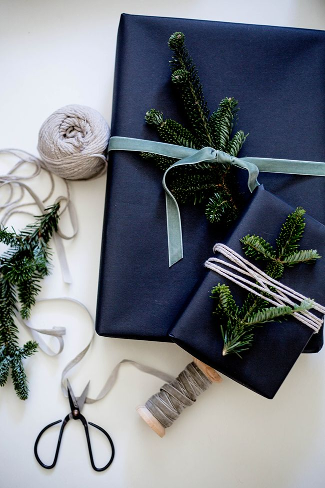 sleek wrapping / black paper, velvet ribbon, twine, and sprigs of pine