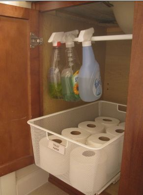 Tension Rod underneath cabinet to store cleaner. I love this. This is perfect for the 1/2 bath and the 2nd bath. Might use the basket idea for TP also.
