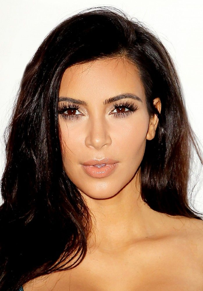Kim Kardashian pulls off a bronzy, just-got-back-from-the-beach look.