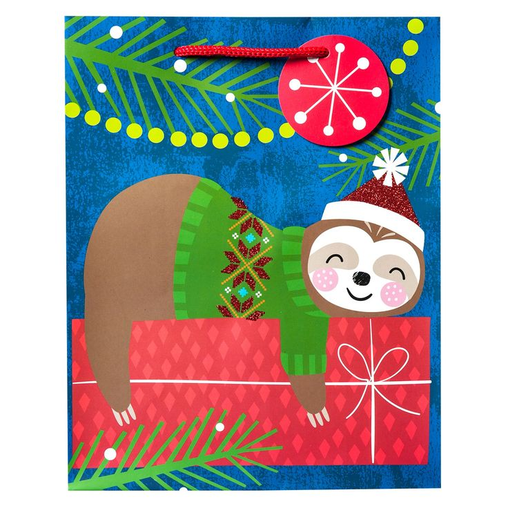 Don't sleep through the holiday season and miss this Sleeping Sloth Gift Bag from Wondershop™. This tropical holiday gift bag features an adorable sloth sleeping on a present with lights dangling from above. The sides of this sloth holiday bag come in a bright green so you keep the traditional holiday color, but use it in a fun, tropical way. This sleeping sloth's sweater and holiday hat are coated in red glitter for a little extra shimmer.
