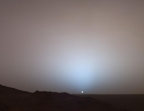 This rare view of a Mars sunset, part of their extensive legacy of images from the martian surface, was recorded by the Spirit rover on May 19, 2005. Image Credit: Mars Exploration Rover Mission, Texas A, Cornell, JPL, NASA.