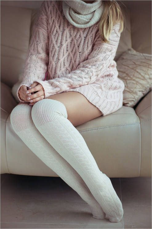 Make a rose pink knit oversized sweater your outfit choice for a casual get-up.   Shop this look on Lookastic: https://lookastic.com/women/looks/pink-knit-oversized-sweater-white-knee-high-socks-white-knit-scarf/14471   — White Knit Scarf  — Pink Knit Oversized Sweater  — White Knee High Socks