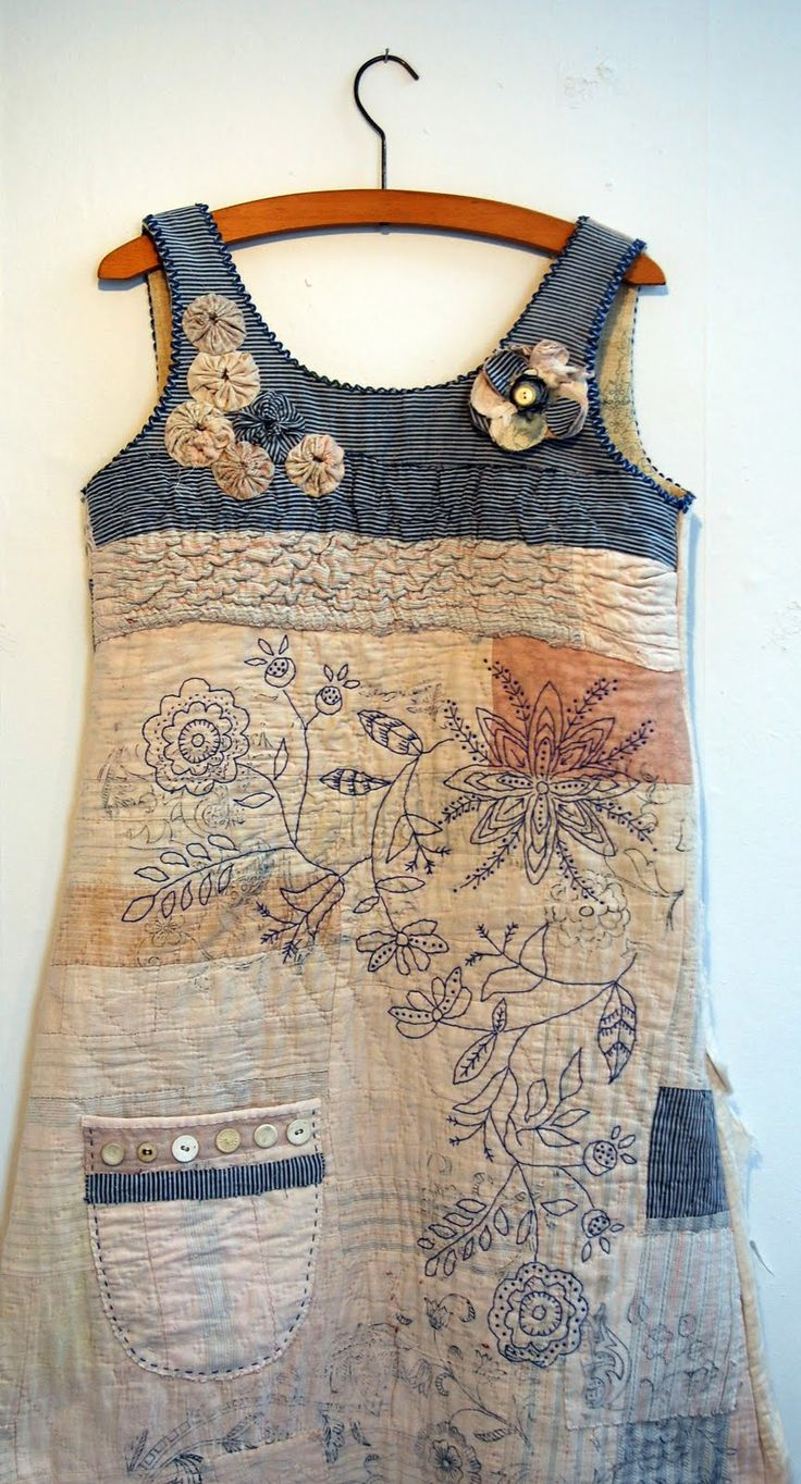 "Mandy Patullo: ""Another recycled vintage quilt. This one has been made up into a dress using a 1980s Clothkits dress pattern. I have over printed and embroidered it and embellished the bodice with my trademark suffolk puffs."""