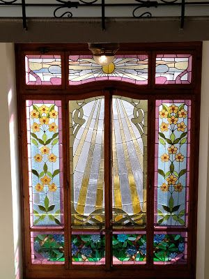 Art Nouveau Stained Glass in a Lakeside Hotel     Here are the stained glass windows that ascend the wall behind the ma...