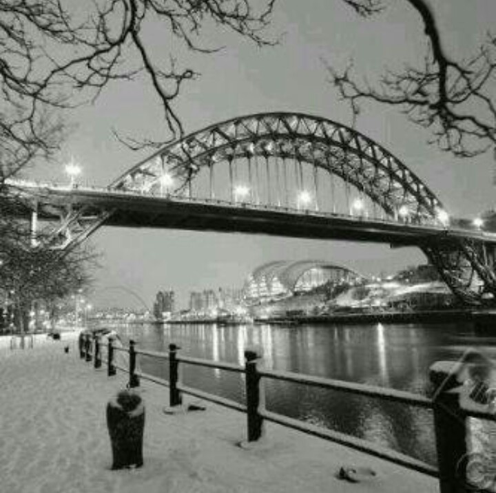 I like how this has a wintery feel to it, they grey effect makes it look like its going to snow again and how the lights on the tyne bridge draw you into the photo