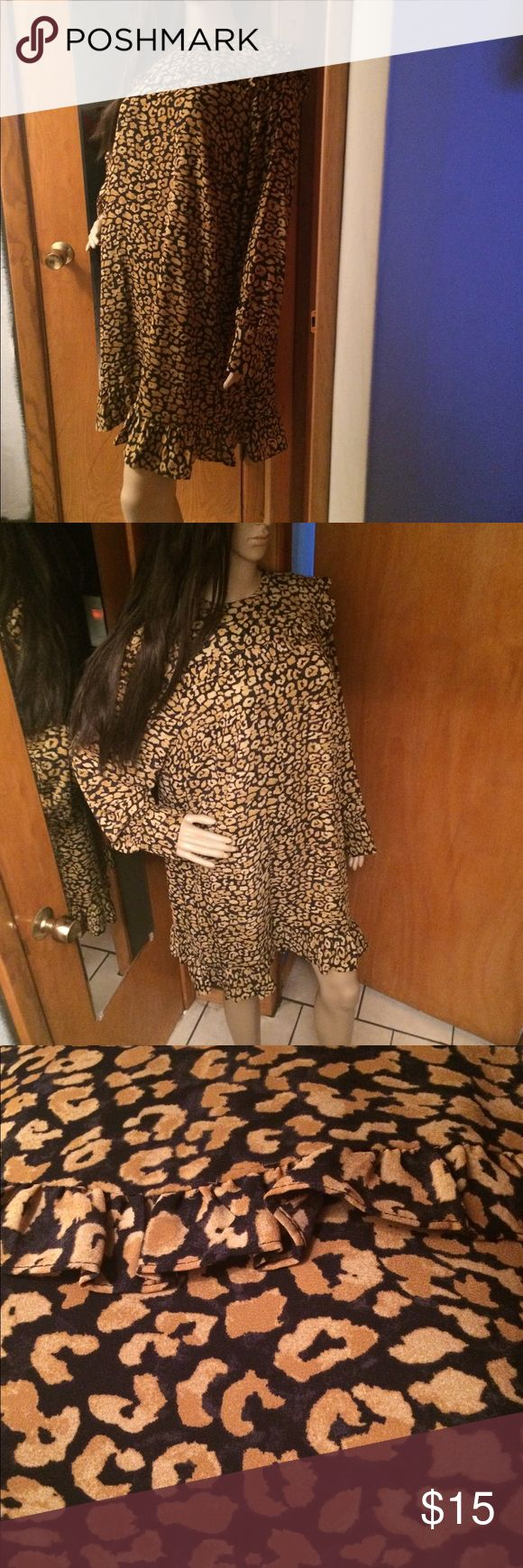 New with Tags leopard cheetah dress New with Tags leopard cheetah dress. Zipper on the back. who what Dresses