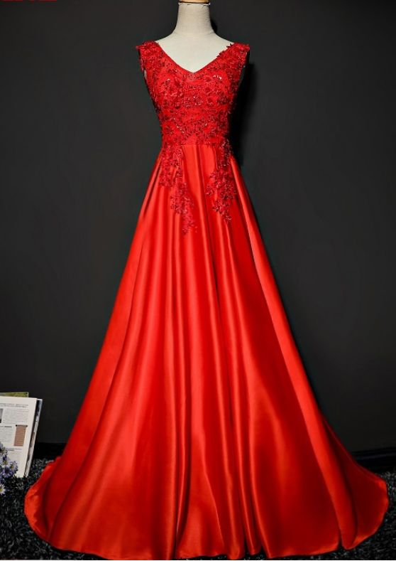Red satin long lacy dresses in a night gown at the party's formal PROM night