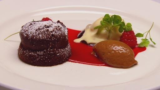 Warm chocolate cake, chocolate mousse, raspberry jam and vanilla bean ice cream