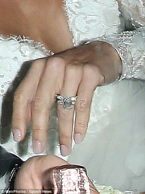 She's a taken lady: Christine proudly showed off her sparkling wedding ring...