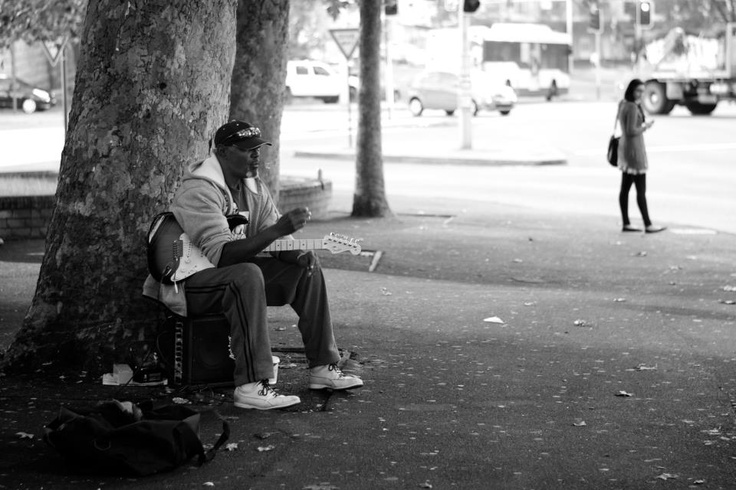 Photo competition: Australiana  Entry from: Nik Herrmann  Image title: Spotted this Aboriginal busker taking a break outside Central Station early friday morning.  Digital camera: SLR digital camera Nikon D300, 50mm 1.8G, f/1.8, 1/200, ISO 200