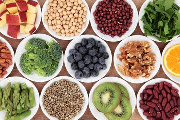 selected of healthy foods arranged in white bowls