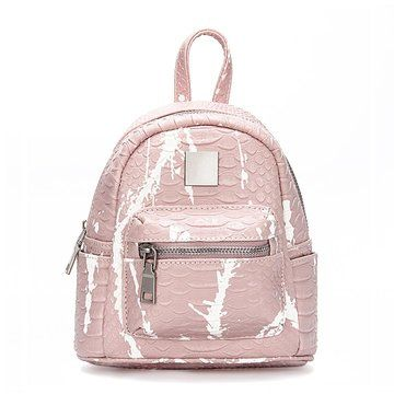 Crafted from sturdy leather-look outer and covered in croc-effect, this mini backpack pops thanks to its cool motif and its practicality. Its zippered front pocket and side pockets are perfect for keeping your most essential pieces - keys, cash - handy while the zippered main compartment is roomy and outfitted with two slip pockets so you can easily store small tech devices, your purse and other treasures without worry.