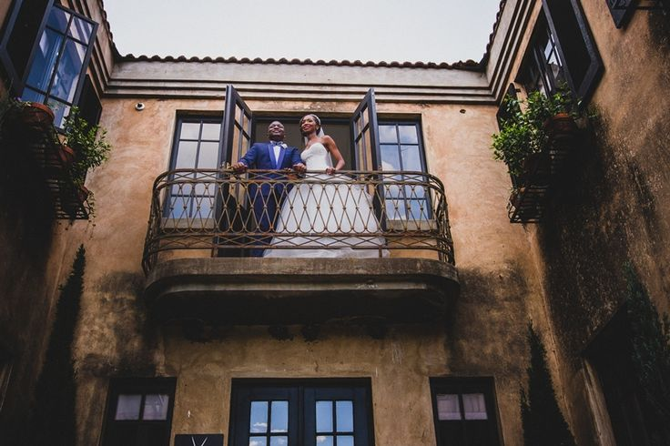 Prince and Princes on the balcony at Avianto Wedding venue Estate with  buildings  build  European style